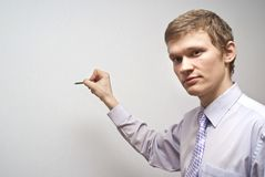 On a gray background business guy Royalty Free Stock Photo