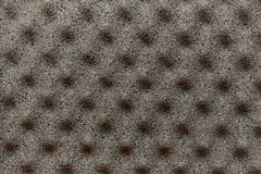 Gray background of foam material with pyramidal protrusions on t stock photo