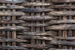 Gray background fragment of an old wicker chair made of wood twigs. Wet texture royalty free stock photos