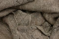 Gray texture from a fragment of an old woolen shawl. Gray background from a fragment of an old woolen shawl royalty free stock image