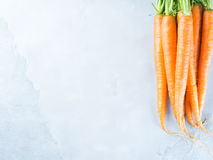 Gray background with fresh raw carrots. Fresh carrots on gray background. Healthy eating diet concept. Vegetables frame on table. Raw organic food Royalty Free Stock Image