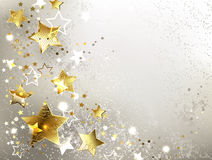 Gray background with gold stars Royalty Free Stock Photography