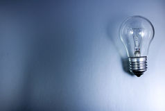 Gray background with a light bulb Royalty Free Stock Photo