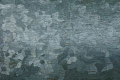 Gray texture of metal from a piece of d old zinc royalty free stock photography