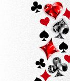 Gray background with polygonal playing cards symbols Royalty Free Stock Photo