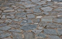 Gray background of a road made of stones of different sizes close up stock photos