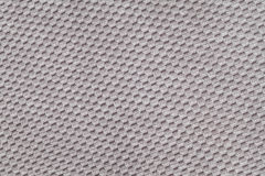 Gray background from soft fleecy fabric closeup. Texture of textile macro Royalty Free Stock Image