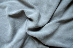 Gray background, soft velor fabric draping Stock Photography
