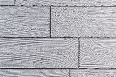 Gray background of wallpaper in the form of imitation boards from light wood. Parquet from brightened aged wood royalty free stock image