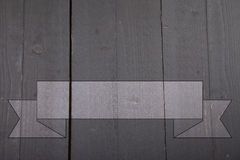 Gray banner on black wooden background Stock Image