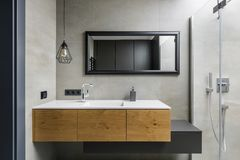 Gray bathroom with countertop basin. Gray bathroom with modern countertop basin, mirror and shower royalty free stock images