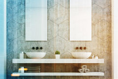 Gray bathroom with two sinks close up. Gray bathroom with a gray wall, two white sinks and two tall rectangular mirrors hanging above them. 3d rendering toned Stock Photos