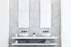 Gray bathroom with two sinks. Gray bathroom with a gray wall, two white sinks and two tall rectangular mirrors hanging above them. 3d rendering Royalty Free Stock Photos