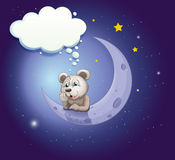 A gray bear leaning over the moon with an empty callout Stock Image