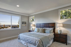Gray bedroom design with queen size bed Stock Photography