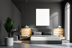 Gray bedroom interior, frame poster. Gray bedroom interior with a concrete floor, a king size bed and a frame vertical poster hanging above it. 3d rendering mock Stock Photo