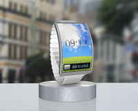 Gray bent interface smartwatch on showcase with steel watchstrap Royalty Free Stock Images