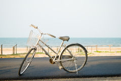 Gray Bicycle parked near beach Royalty Free Stock Images