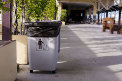 Gray bin for general waste at bus terminal Royalty Free Stock Photos