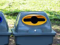 Gray bins for waste sorting are in the public park in bangkok thailand. recycle concept.  stock photos