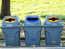Gray bins for waste sorting are in the public park in bangkok thailand. recycle concept.  Royalty Free Stock Images