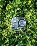 Gray and Black Action Camera on Green Leaves Plants Stock Photo