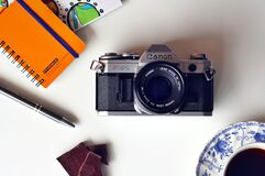 Gray and Black Canon Mirrorless Camera Beside Blue and White Ceramic Plate Royalty Free Stock Photo