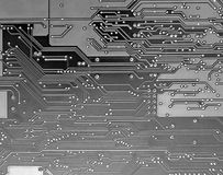 Gray and Black circuit board. Detail of circuit board, solderings, paths stock images