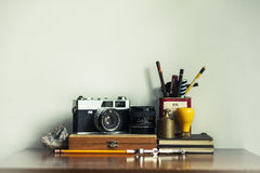 Gray and Black Dslr Camera on Brown Wooden Case Royalty Free Stock Image