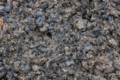 Gray black natural texture of ash and earth. Gray black natural background of ash and earth royalty free stock images