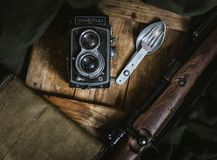 Gray and Black Rolleiflex Camera Beside Fork and Spoon Decor Royalty Free Stock Photo