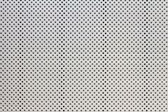 Gray and black small polka dots pattern, abstract background with a holes.  royalty free stock photo