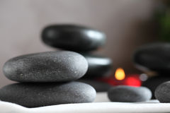 Gray and black stacked massage stones Royalty Free Stock Photo