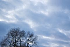 Gray and blue clouds, densely covering the sky, at the bottom le stock photography
