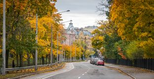 Gray and Blue Concrete Building Surrounded With Yellow Leafed Trees at Daytime Stock Photography