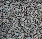 Gray-blue crushed stone texture. A large pile of gray-blue gravel photographed from a close distance Stock Images