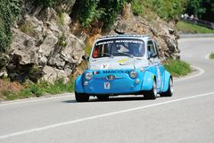 A gray and blue Fiat Abarth 595 takes part to the Nave Caino Sant'Eusebio race Royalty Free Stock Photography