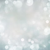 Gray, blue and green   Festive background. Gray and blue festive bokeh background with light beams Stock Images