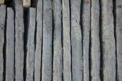 A gray blue vertical uneven concrete blocks. vertical lines. rough surface texture. Gray blue vertical uneven concrete blocks. vertical lines. rough surface stock photos