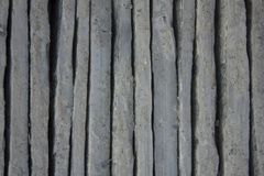 Gray blue vertical uneven concrete blocks. vertical lines. rough surface texture. A gray blue vertical uneven concrete blocks. vertical lines. rough surface royalty free stock photography