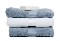 Gray blue and white towels with a bar of soap Royalty Free Stock Image