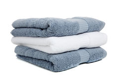 Gray blue and white towels with soap on white Royalty Free Stock Photography