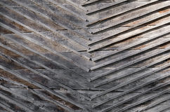 Gray boards nailed to the wall of wood boards Royalty Free Stock Image