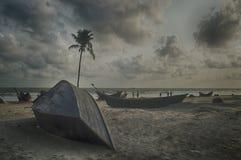 Gray Boat on Gray Sand Beach Under Gray Cloudy Sky Royalty Free Stock Photo