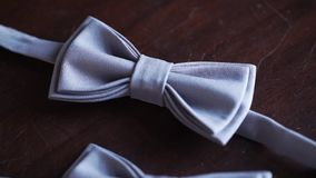 Gray bow tie. On wooden background for bestman and groom at the wedding stock video footage