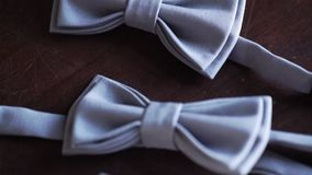 Gray bow tie. On wooden background for bestman and groom at the wedding stock footage