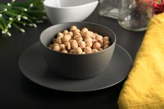 Gray Bowl with  hazelnuts royalty free stock photos
