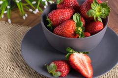 Gray Bowl with strawberries stock images