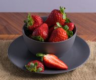 Gray Bowl with strawberries royalty free stock photo