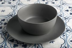 Gray Bowl in a tiles background royalty free stock images